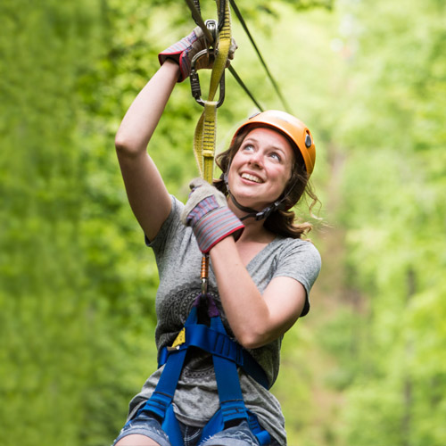 Soar through the air with Legacy Mountain Premier Ziplines.