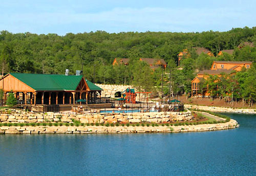 View of the pavilion and pool from across Fox Hollow Lake - StoneBridge Resort in Branson West, Missouri