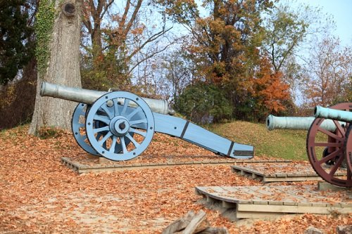 A cannon at the Yorktown Battlefield against a fall backdrop