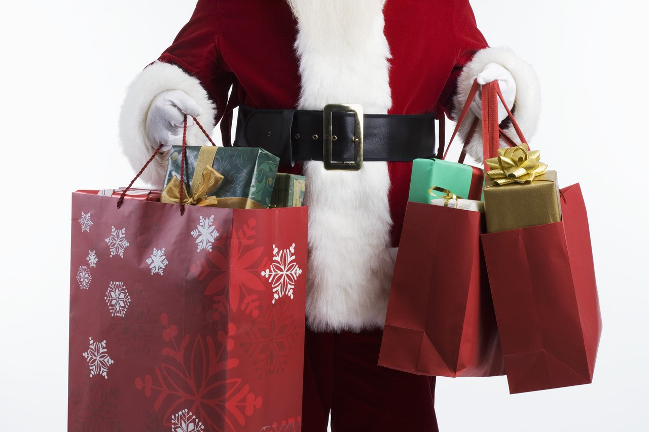 Santa Carrying Shopping Bags things to do in branson during winter