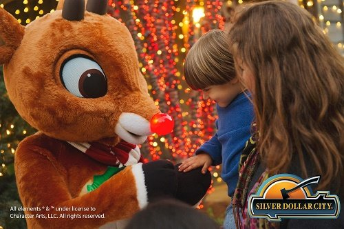 A child meets Rudolph the Red Nosed Reindeer (Costume) at Silver Dollar City