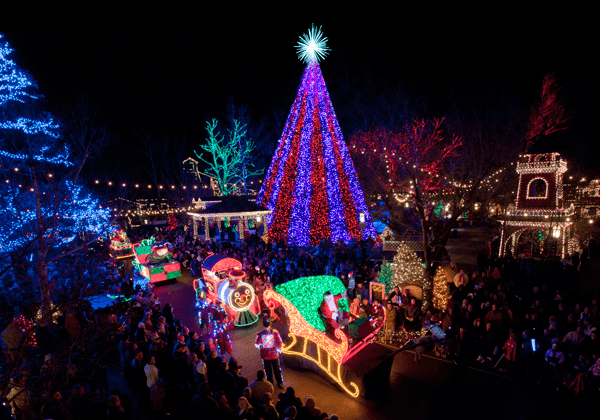 Main Street in Silver Dollar City glowing with Christmas lights and a giant tree
