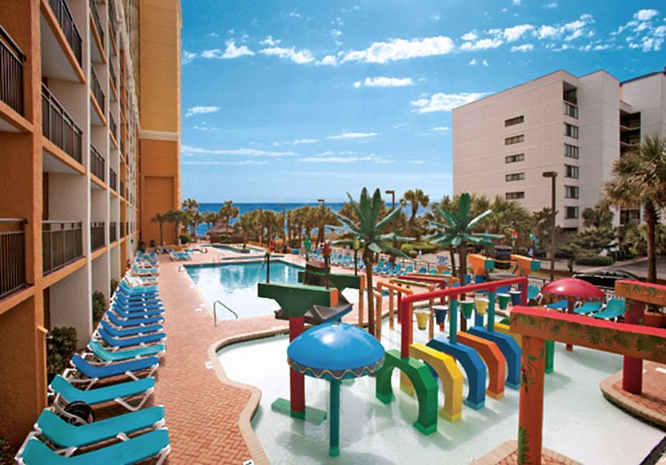 The outdoor pool and play area at the Caravelle Resort