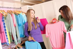 Two girls shopping in Myrtle Beach at a store with bright colored clothing