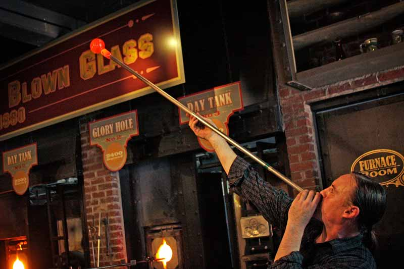 A glassblower creates a work of art at Silver Dollar City