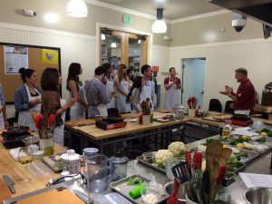 A group takes a cooking class at Sur la Table, one of the most romantic things to do in San Diego for couples
