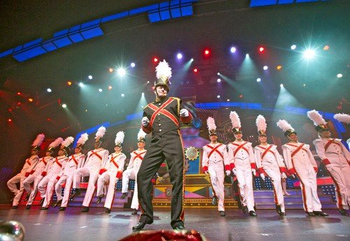Performers dressed as toy soldiers dance in a Pigeon Forge Christmas show