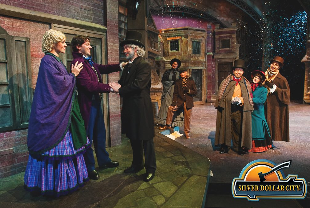Actors in A Dickens' Christmas Carol act out a scene on stage