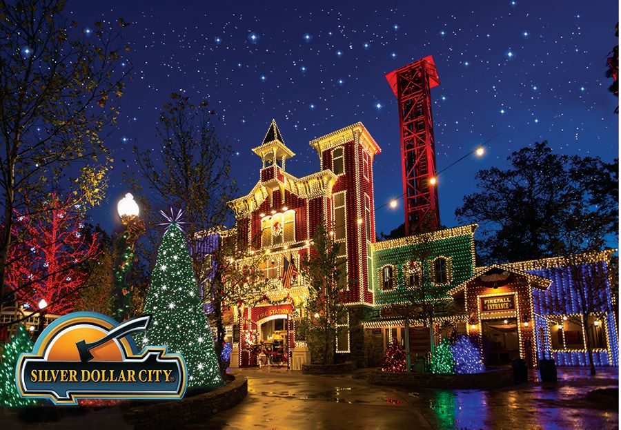 Silver Dollar City buildings lit up with Christmas lights for an Old Time Christmas celebration
