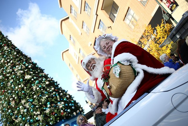 "Mr. and Mrs. Claus wave to the crowd during Branson's ""Most Wonderful Time of Year"" Parade."