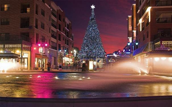 A festive Christmas tree adorns The Branson Landing at night during the holidays