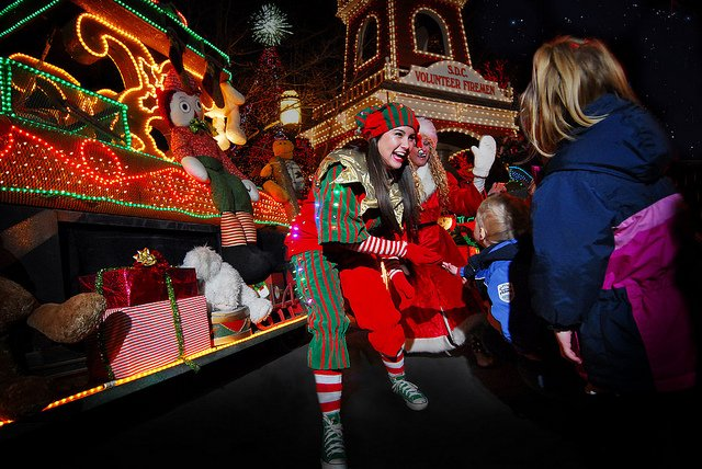 Women dressed as Christmas elves greet Silver Dollar City visitors during an Ozark Mountain Christmas