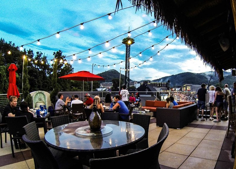 Rooftop bar in the Smoky Mountains under strategically strung lightbulb fixtures