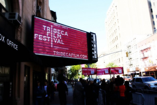 """The Tribeca Film Festival NYC marquee with a red background and white words spelling out """"Tribeca Film Festival"""""""