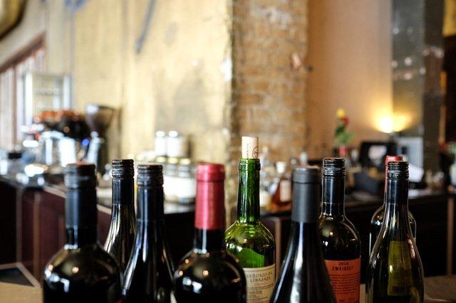 Red wine bottles in a rustic Italian restaurant