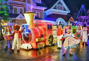 The parade during Dollywood's Smoky Mountain Christmas features thousands of lights and larger than life toys and characters.