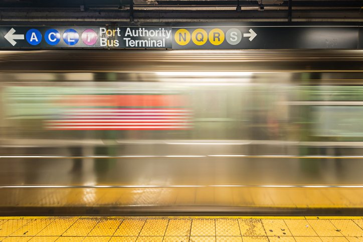 An empty track of New York Subway when train passes by.