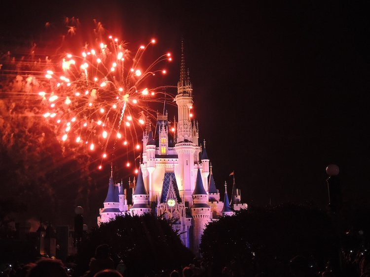 Fireworks explode over Cinderella Castle during a guest's first Disney World trip.