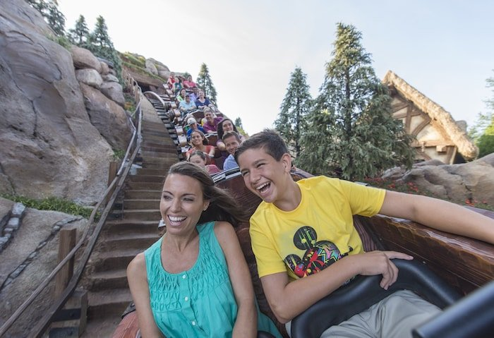 Visitors ride a rollercoaster during their first Disney World trip.