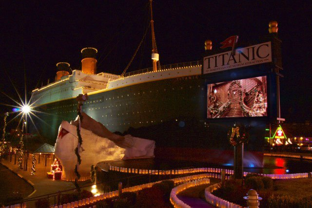 Luminaries line the pathway to the entrance of the Titanic Museum Attraction, which is a replica of the famed ship.