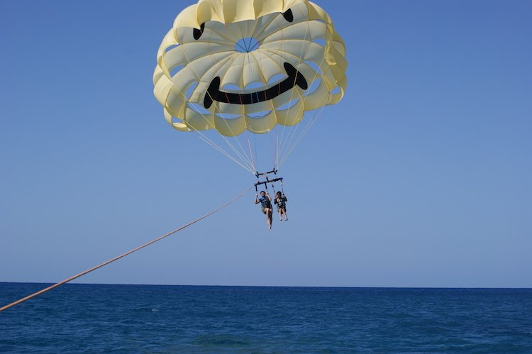 Parasailing is one of the many water activities that await you in Honolulu.