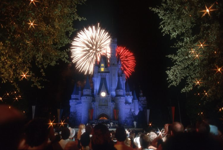 Fireworks explode over Cinderella Castle at night