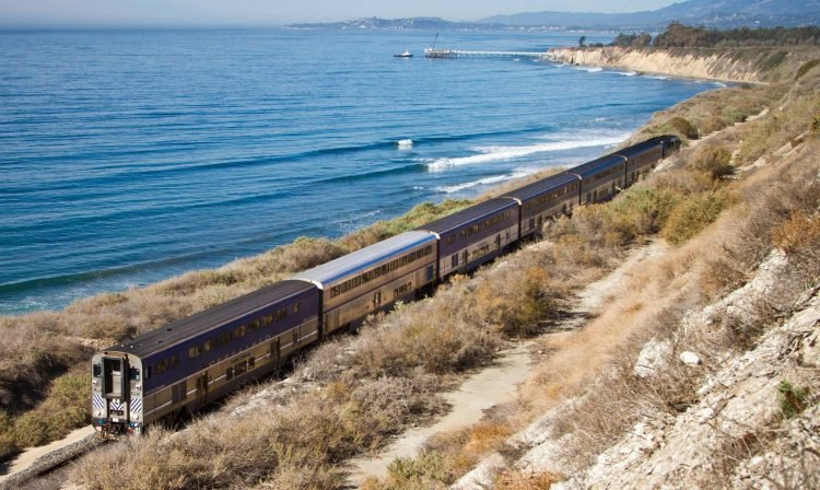 The Pacific Surfliner train rides along the San Diego coast