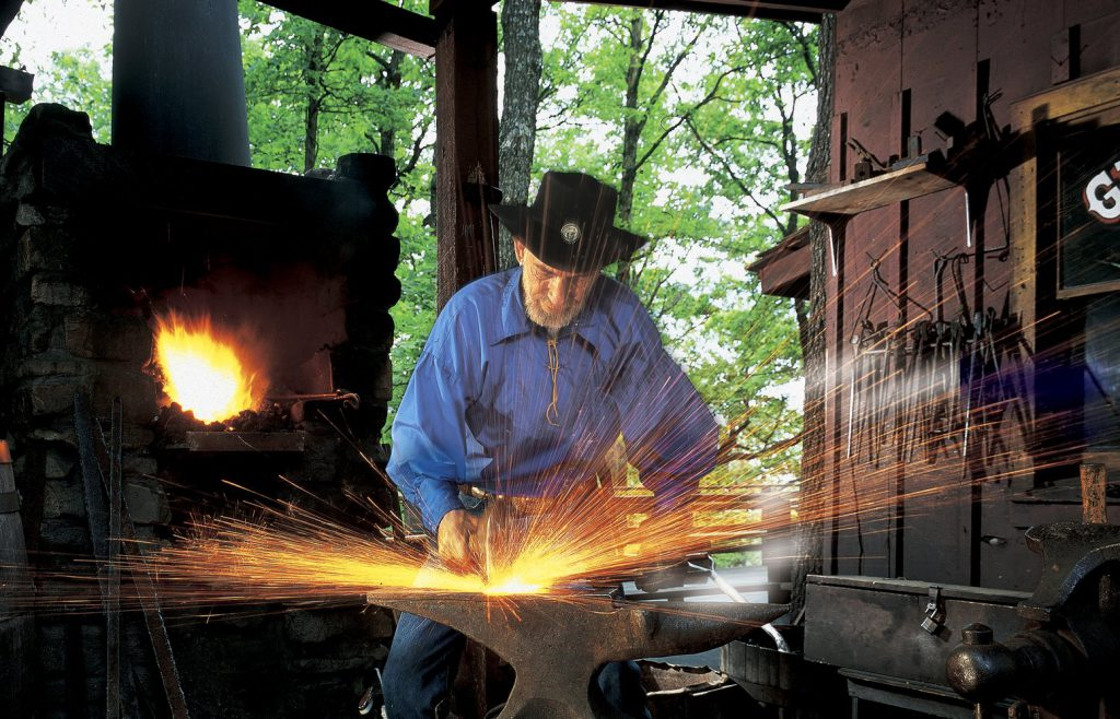 Things to Do at Silver Dollar City this Fall include watching professional blacksmiths and craftsmen.