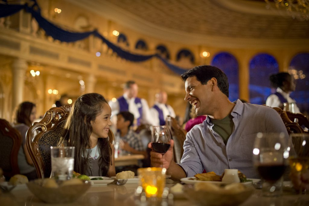 A Dad and Daughter celebrate a Disney World Thanksgiving inside an upscale restaurant decked out in holiday decor