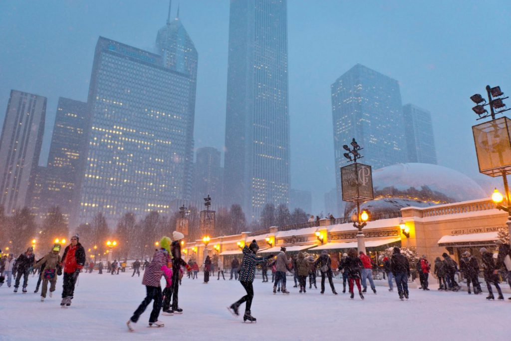 Tourists ice skate in Millennium Park on a snowy Chicago night