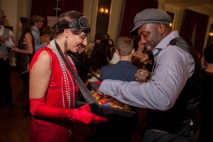 Guests of the Chicago History Museum dress up in Prohibition era attire and enjoy the event