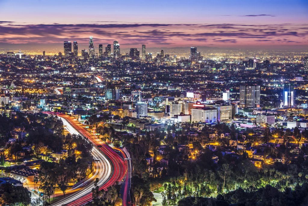 The Los Angeles skyline and cityscape lit up at dusk