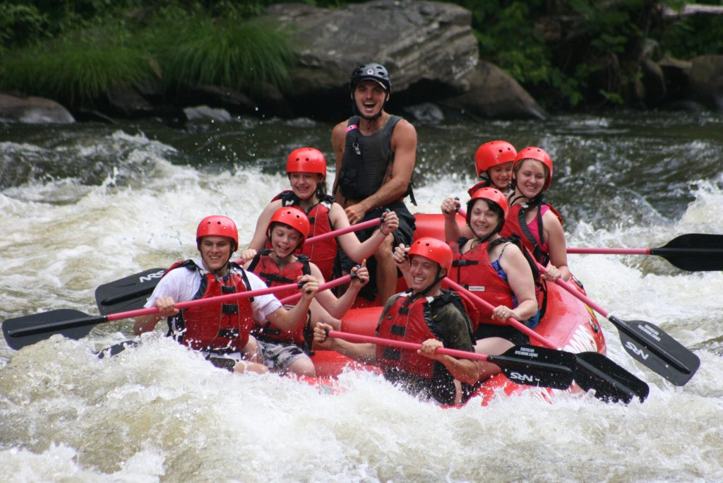 A group of friends goes white water rafting in Gatlinburg in the Spring