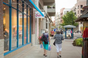 Two women shopping at Branson Landing, as one of the top things to do in Branson for adults.