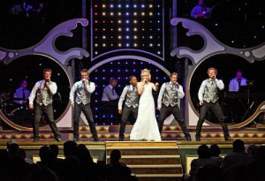 Group singing in a Branson show. Things to do in Branson for adults.