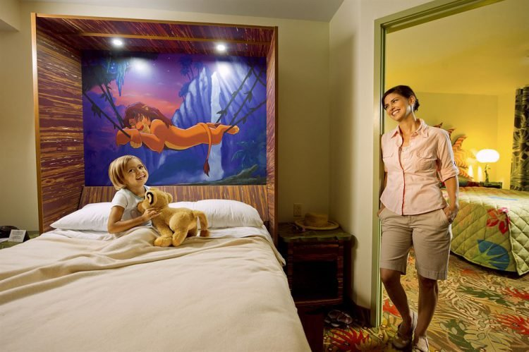 Woman and child in a Lion King themed Disney World hotel room.