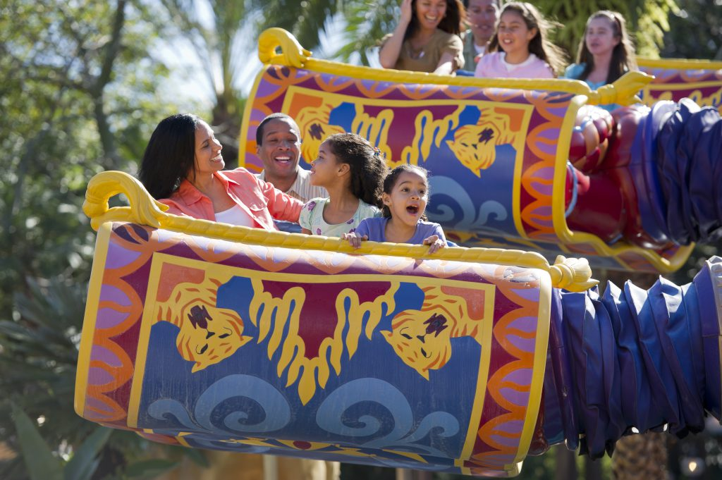 Family on the Aladdin Magic Carpet ride in Magic Kingdom - Benefits of Staying on Disney Property