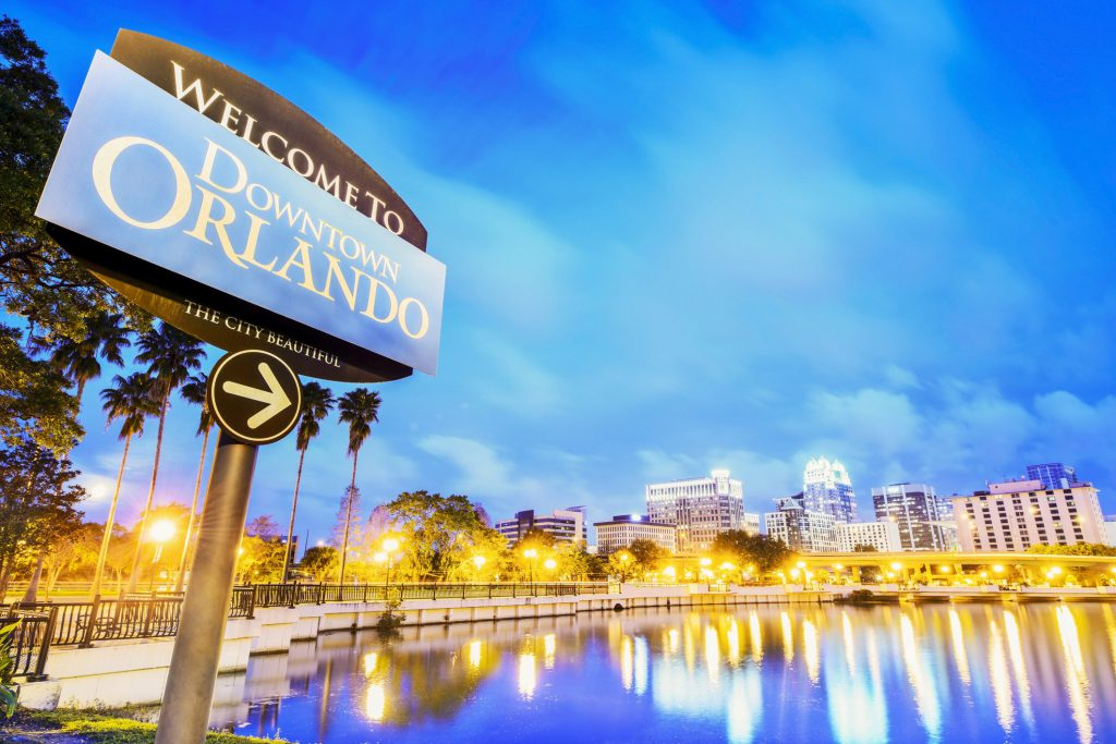 Downtown Orlando sign overlooking the lake and skyline.