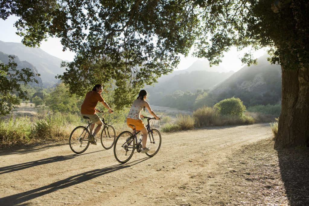 Couples biking along a dirt path in Los Angeles