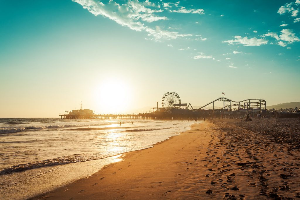 Los Angeles beach at sunset with pier in background - things to do in Los Angeles during summer
