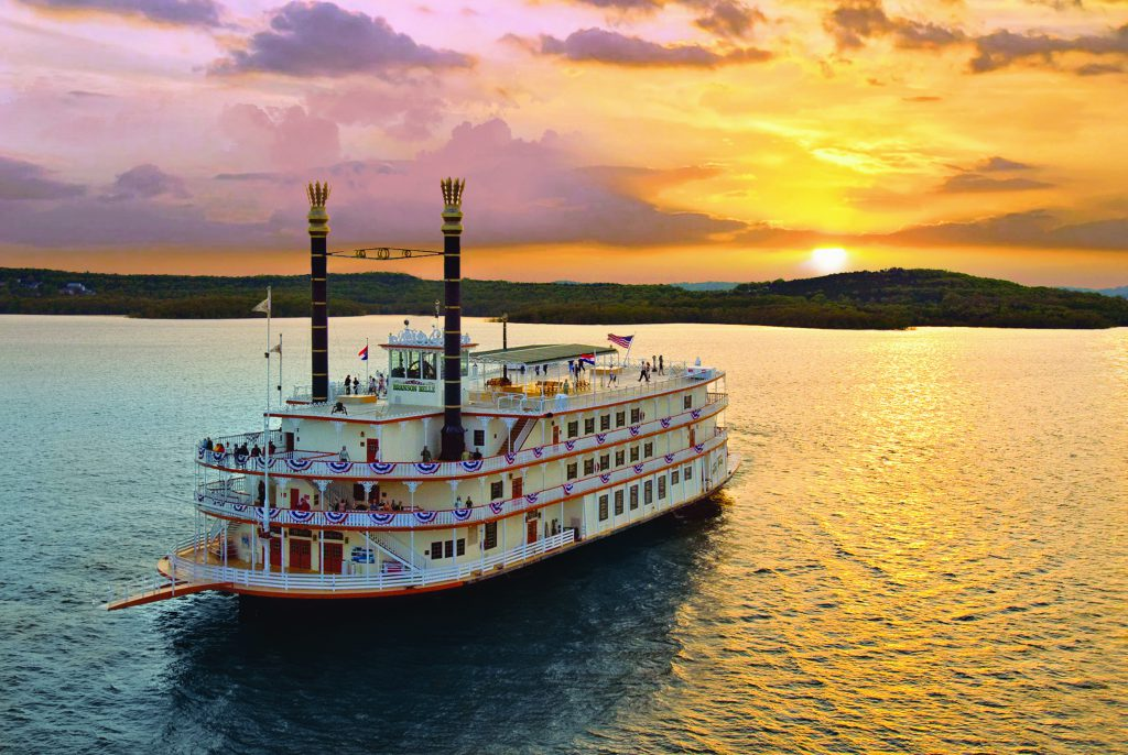 The Showboat Branson Belle sails across Table Rock lake at Sunset