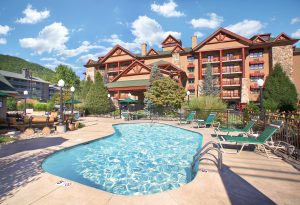 The outdoor pool at Bearskin Lodge and hotel exterior