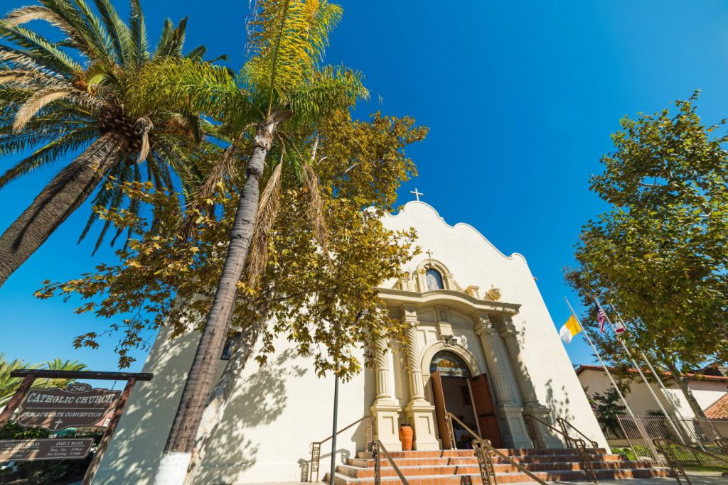 The Catholic Church with a palm tree in Old Town San Diego