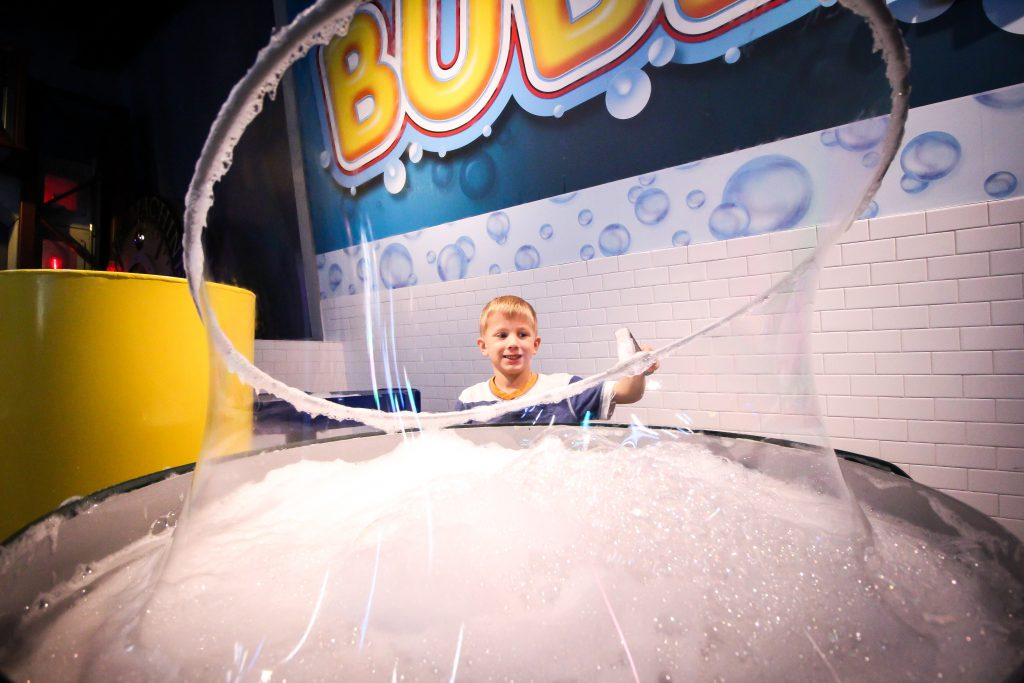 Boy plays with bubbles at WonderWorks in Myrtle Beach