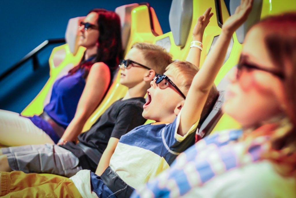 Family rides the 6D Motion Ride with yellow seats at WonderWorks Myrtle Beach SC