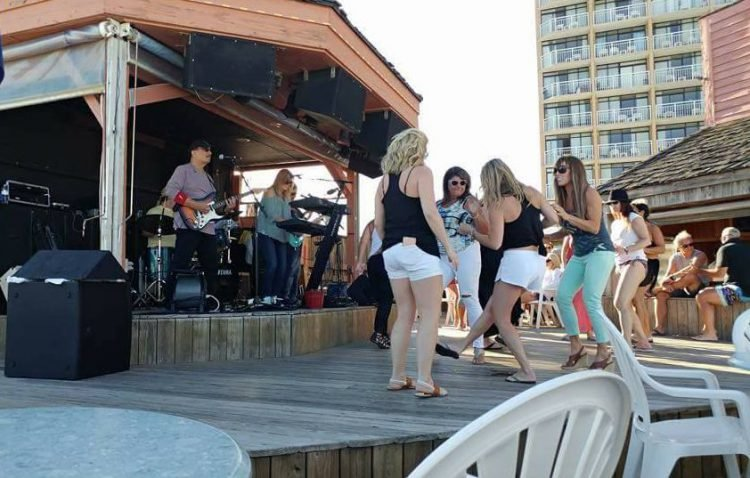 Girls dance to a live band at Ocean Annie's