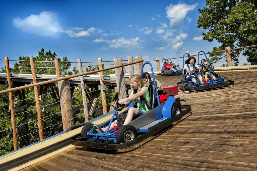 Girl rides a go-kart at The Track Branson