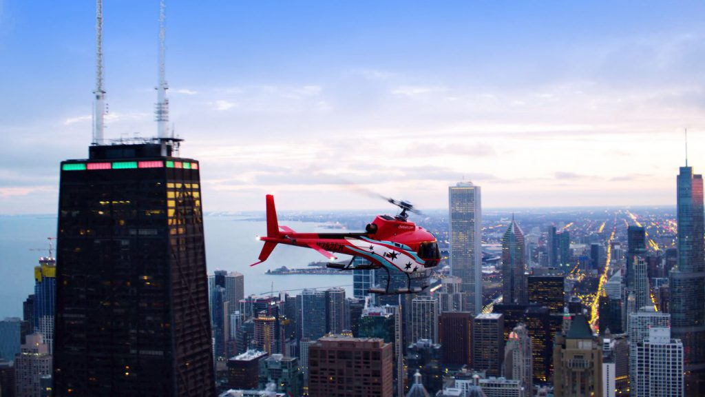 Helicopter flies over Chicago at dusk