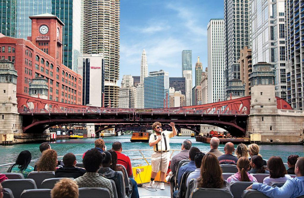 Passengers listen to a tour guide on Seadog Chicago Cruises on the Chicago River