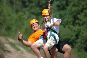 Man and boy ziplining in Branson, MO